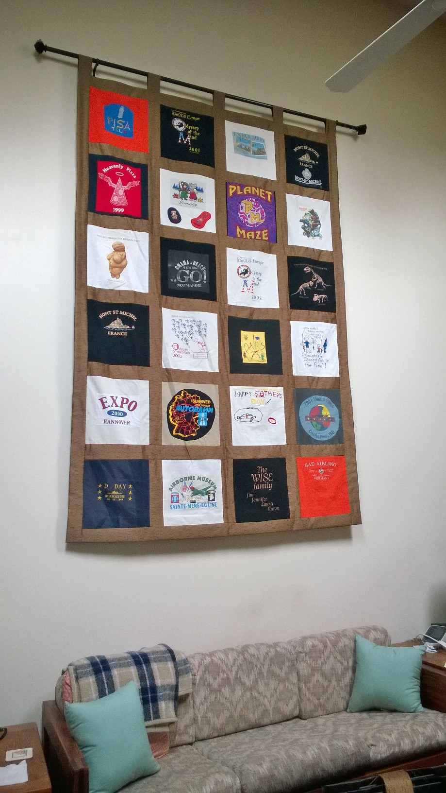 Memory Quilt with Sashing used as wall hanging
